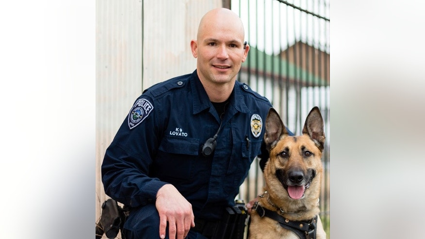 The police K9, Aldo, and Officer Luis Lovato.