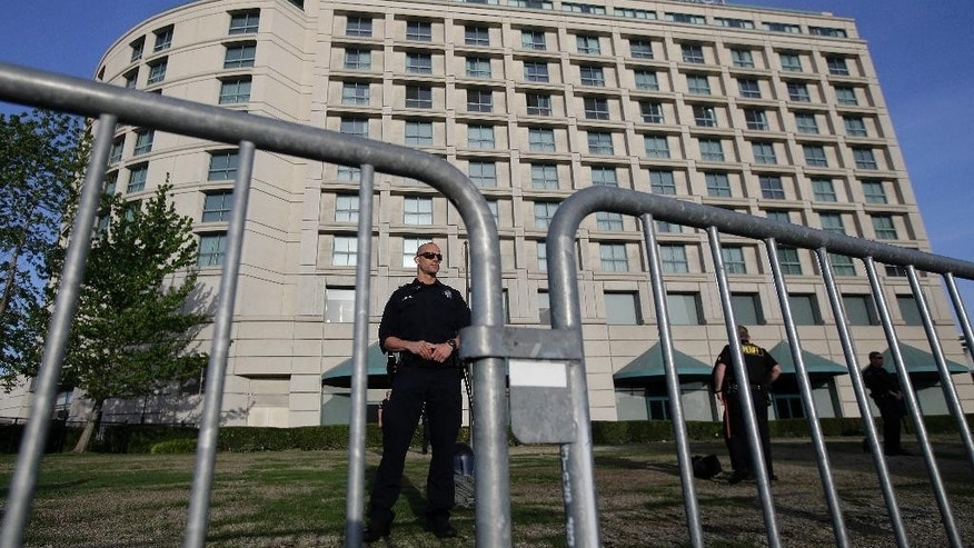 A police officer stands outside of the Hyatt Regency hotel before the California Republican Party 2016 Convention in Burlingame, Calif., Friday, April 29, 2016. (AP Photo/Jeff Chiu)