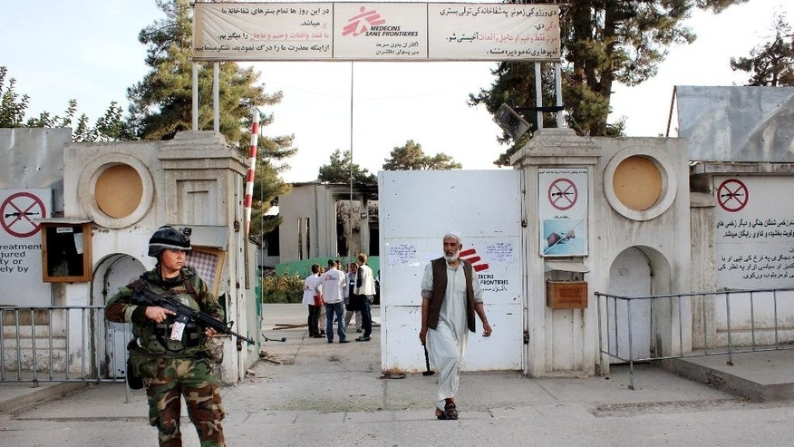 FILE - In this Thursday, Oct. 15, 2015 file photo, an Afghan National Army soldier stands guard at the gate of a Doctors Without Borders hospital in Kunduz, Afghanistan. About 16 U.S. military personnel, including a two-star general, have been disciplined for mistakes that led to the bombing of the civilian hospital in Afghanistan last year that killed 42 people, a senior U.S. official said Thursday, April 28, 2016. According to officials, no criminal charges were filed and the service members received administrative punishments in connection with the U.S. airstrike in the northern city of Kunduz.   (AP Photo/Najim Rahim, File)