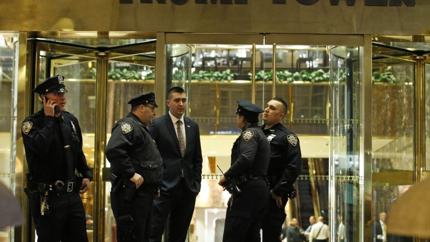 April 28, 2016: olice officers stand outside Trump Tower on Manhattan's Fifth Avenue where detectives and other agencies were investigating a suspicious white powdery substance found inside the building in New York.