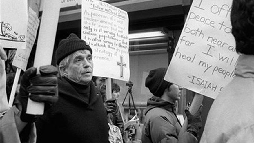 File-This April 9, 1982, file photo shows Daniel Berrigan marching with about 40 others outside of the Riverside Research Center in New York. The Roman Catholic priest and Vietnam war protester, Berrigan has died. He was 94. Michael Benigno, a spokesman for the Jesuits USA Northeast Province, says Berrigan died Saturday, April 30, 2016, at a Jesuit infirmary at Fordham University.  (AP Photo/Marty Lederhandler, File)