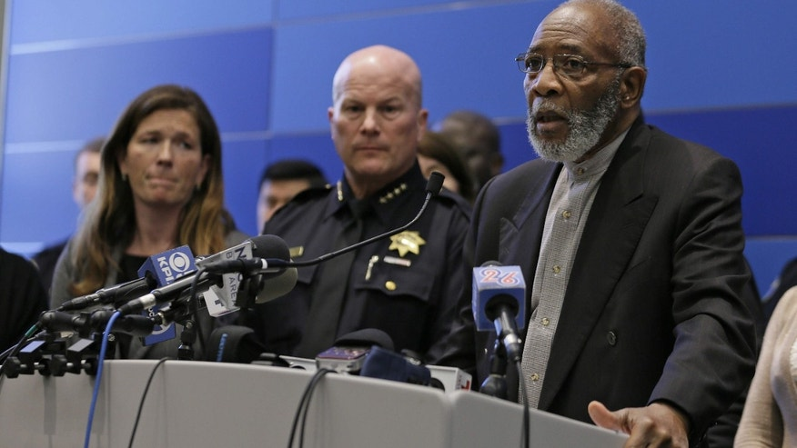 Rev. Amos Brown, right, of the NAACP, speaks as San Francisco Police Chief Greg Suhr, center, and Suzy Loftus, left, President of the San Francisco Police Commission, listen during a news conference in San Francisco.