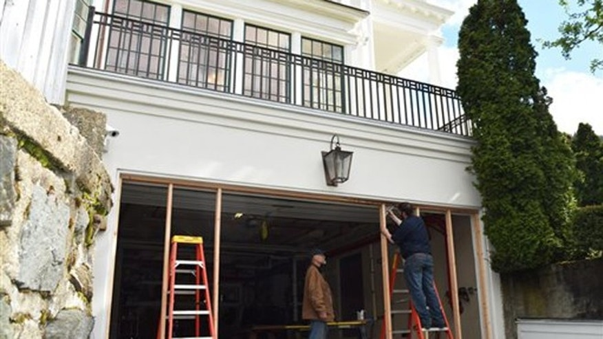 State employees seal off the Governor Mansion's garage door entryway on Indian Street Friday, April 29, 2016, after an alleged drunken driver rammed into it Thursday.  (Paula Ann Solis/The Juneau Empire via AP)