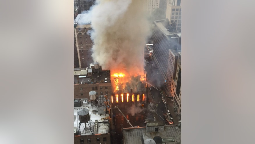 Firefighters battle flames at an historic Serbian Orthodox Cathedral of St. Sava in New York, Sunday, May 1, 2016. The church was constructed in the early 1850s and was designated a New York City landmark in 1968. (Anindya Ghose via AP) MANDATORY CREDIT