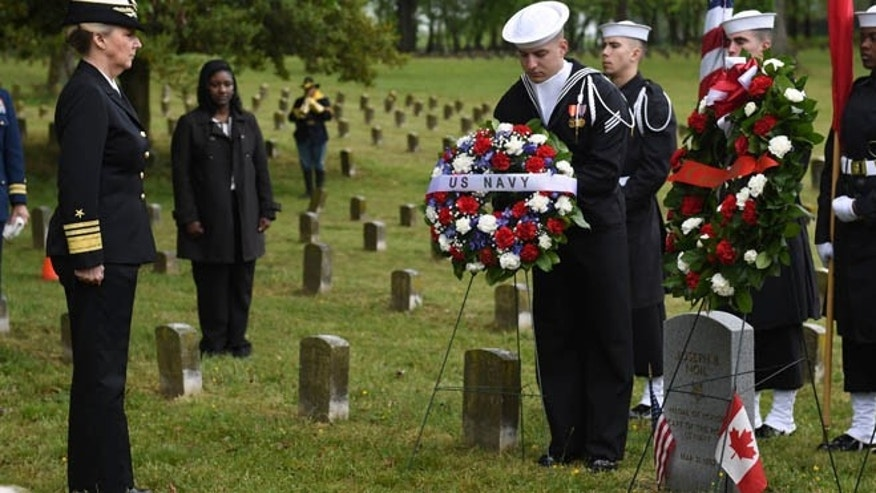 Chief of Navy Reserve Vice Adm. Robin Braun observes the wreath presentation by Sailors assigned to the U.S. Navy Ceremonial Guard at the headstone ceremony April 29, 2016 for Medal of Honor recipient Joseph B. Noil at St. Elizabeths Hospital Cemetery. (U.S. Navy)