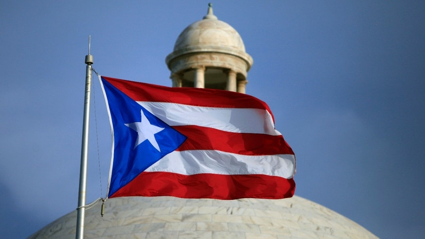 The Puerto Rican flag flies in front of Puerto Rico's Capitol in San Juan.