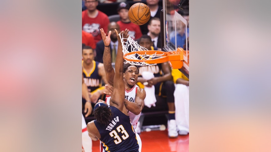 Toronto Raptors guard DeMar DeRozan (10) drives to the net past Indiana Pacers forward Myles Turner (33) during second half round one NBA playoff basketball action in Toronto on Sunday, May 1, 2016. (Nathan Denette/The Canadian Press via AP)