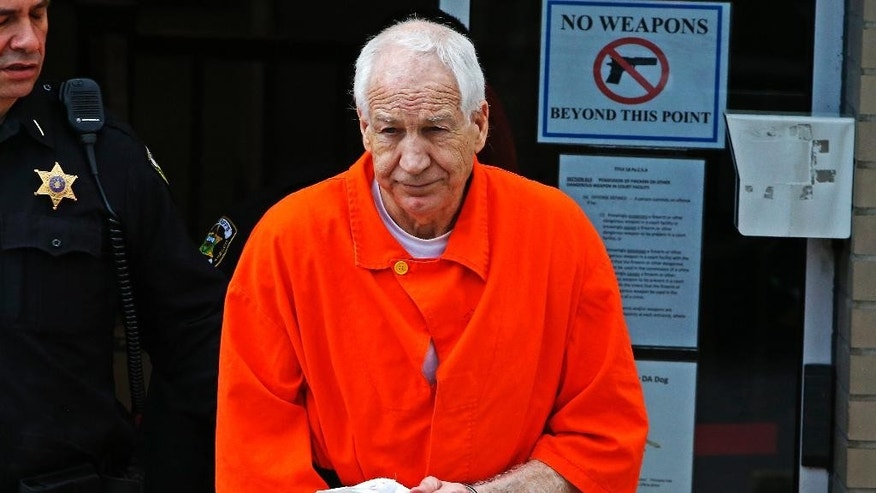 Former Penn State University assistant football coach Jerry Sandusky leaves the Centre County Courthouse after a hearing of arguments on his request for an evidentiary hearing as he seeks a new trial in Bellefonte, Pa. Monday, May 2, 2016. (AP Photo/Gene J. Puskar)