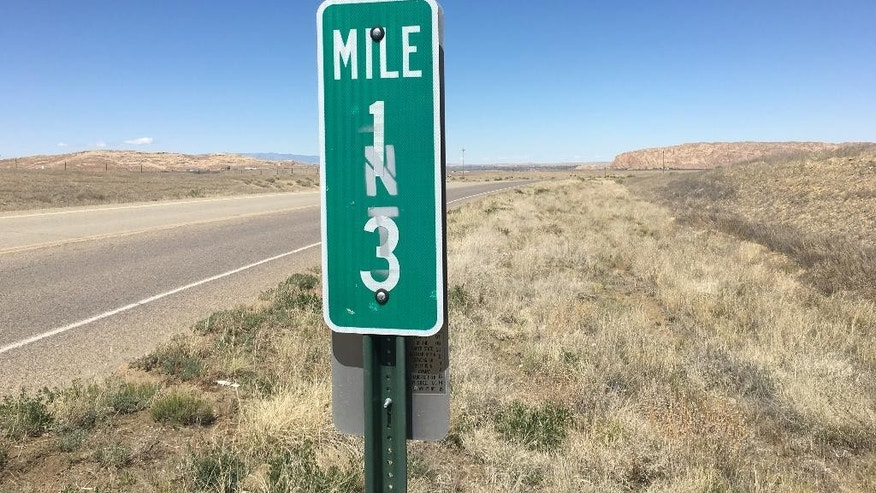 The 13 mile marker is posted off Navajo Route 36 near the San Juan Chapter, N.M., on Tuesday, May 3, 2016. An 11-year-old girl and her brother were abducted on Monday, May 2, 2016, near this mile marker off Navajo Route 36 near the San Juan Chapter, N.M., according to authorities. (Jon Austria/The Daily Times via AP) MANDATORY CREDIT