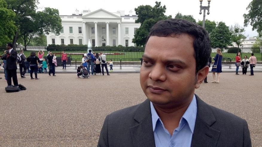 "Bangladeshi blogger and social activist Ashif Entaz Rabi stands outside the White House in Washington, Tuesday, May 3, 2016. When Rabi hosted a TV talk show about a slaying of a publisher by Islamic extremists, he faced a torrent of threatening phone calls. He says young men with earpieces started loitering outside his workplace, and a militant website urged followers to ""send this Ashif to Allah.""  (AP Photo/Dan Huff)"