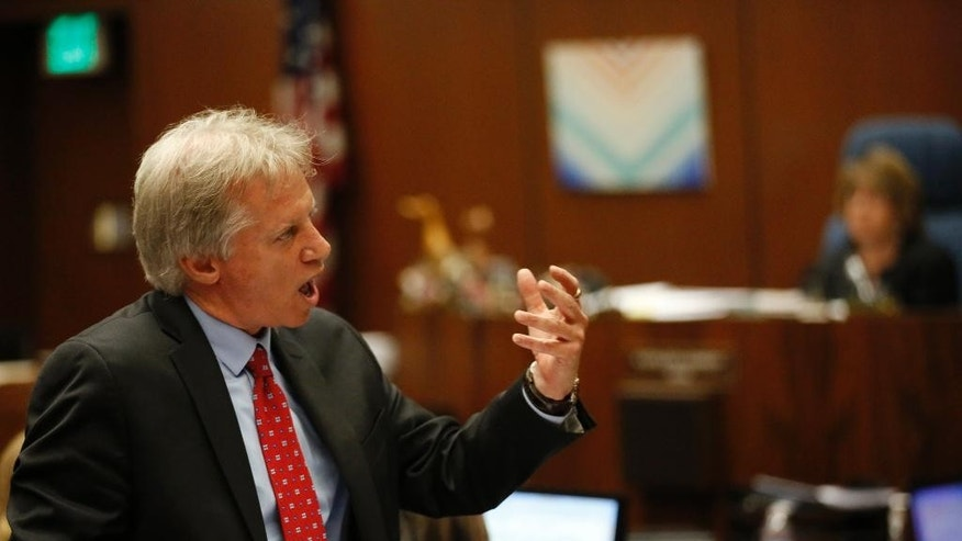 "Defense attorney Seymour Amster makes his final arguments during Lonnie Franklin Jr.'s trail in Los Angeles Superior Court during closing arguments of Franklin's trail Monday, May 2, 2016, in Los Angeles. The ""Grim Sleeper"" serial killer trial is coming to a close in Los Angeles after months of testimony. Franklin is charged with killing nine women and a 15-year-old girl between 1985 and 2007. They were shot or strangled and their bodies dumped in alleys and trash bins in South Los Angeles and nearby areas. (Mark Boster/Los Angeles Times via AP, Pool)"