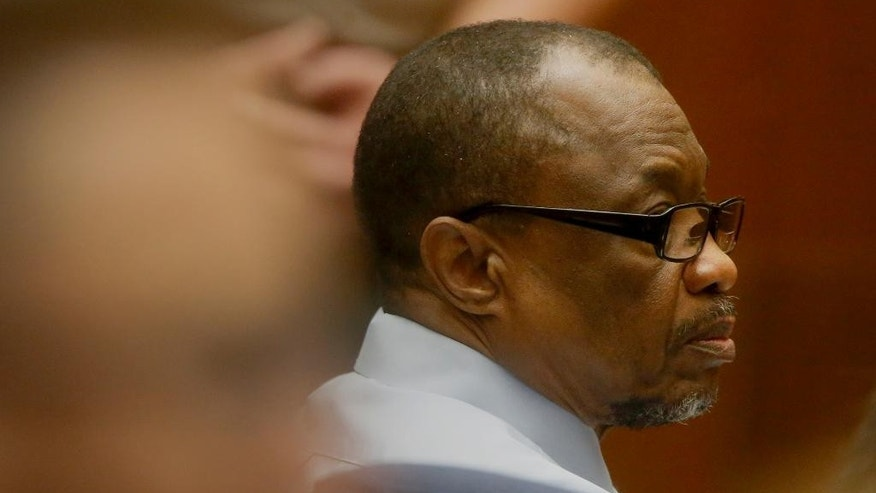 "Lonnie Franklin Jr. appears in Los Angeles Superior Court during closing arguments of his trail Monday, May 2, 2016, in Los Angeles. The ""Grim Sleeper"" serial killer trial is coming to a close in Los Angeles after months of testimony. Franklin is charged with killing nine women and a 15-year-old girl between 1985 and 2007. They were shot or strangled and their bodies dumped in alleys and trash bins in South Los Angeles and nearby areas. (Mark Boster/Los Angeles Times via AP, Pool)"