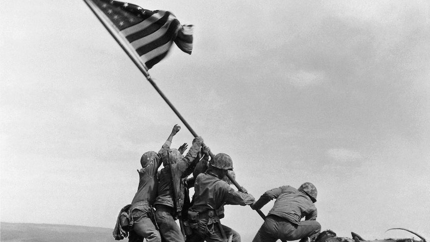 Feb. 23, 1945: U.S. Marines of the 28th Regiment, 5th Division, raise a U.S. flag atop Mount Suribachi, Iwo Jima