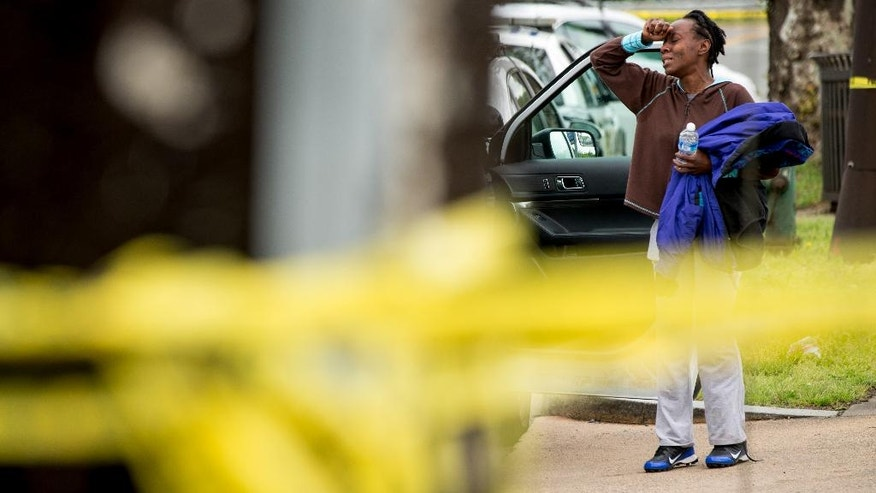 A woman, who was said to know a victim, is emotional near the crime scene.