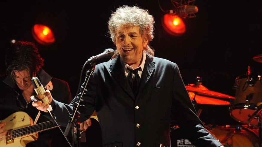 FILE - In this Jan. 12, 2012, file photo, Bob Dylan performs in Los Angeles. Goldenvoice announced Tuesday, May 3, 2016, that the Rolling Stones, Dylan, Paul McCartney, Neil Young, Roger Waters and the Who will perform during a three-day concert at the desert grounds where the annual Coachella music festival is held. (AP Photo/Chris Pizzello, File)