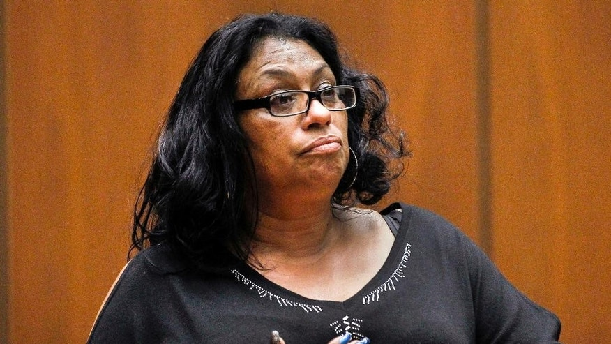 "FILE - In this Feb. 6, 2015 file photo, Enietra Washington pauses to compose her thoughts as she notices serial killer suspect Lonnie Franklin Jr., during a preliminary hearing in Los Angeles Superior Court. Washington is the sole known survivor in 10 ""Grim Sleeper"" serial killings. Franklin was convicted Thursday, May 5, 2016, of the serial killings that spanned two decades and targeted vulnerable young black women in the inner city. (AP Photo/Nick Ut, File)"
