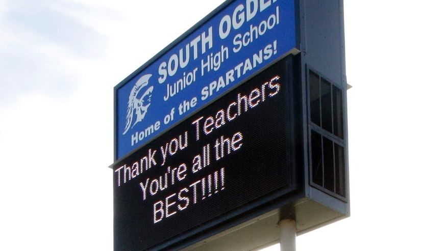 The South Ogden Junior High School sign is shown Wednesday, May 4, 2016, in South Ogden, Utah.