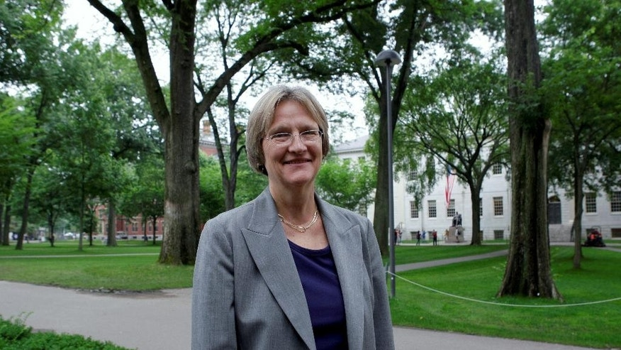 FILE - In this June 30, 2009, file photo, Harvard University President Drew Faust, the university's first female president, poses for a photograph on the university's campus in Cambridge, Mass. Faust announced Friday, May 6, 2016, that students who join Harvard's male-only social clubs won't be able to serve as sports captains or leaders of other campus groups starting in fall 2017. (AP Photo/Charles Krupa, File)