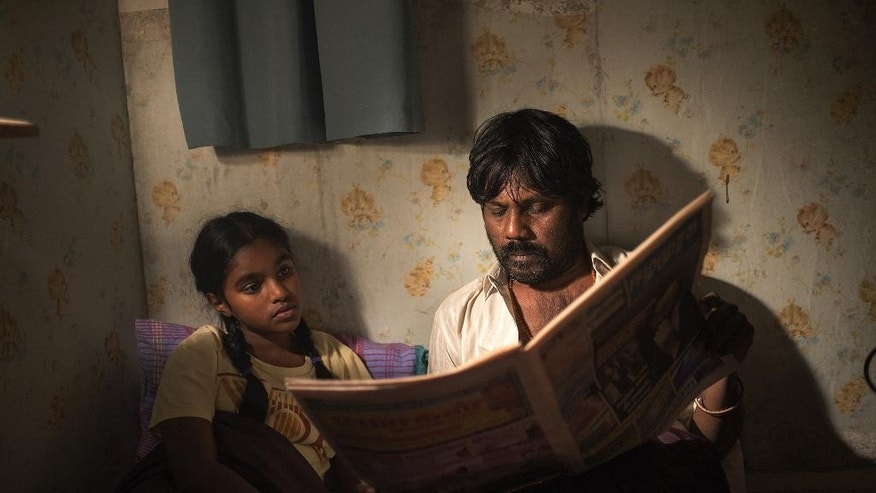 "This image released by Sundance Selects shows Claudine Vinasithamby, left, and Jesuthasan Antonythasan in a scene from ""Dheepan."" (Paul Arnaud/Sundance Selects via AP)"