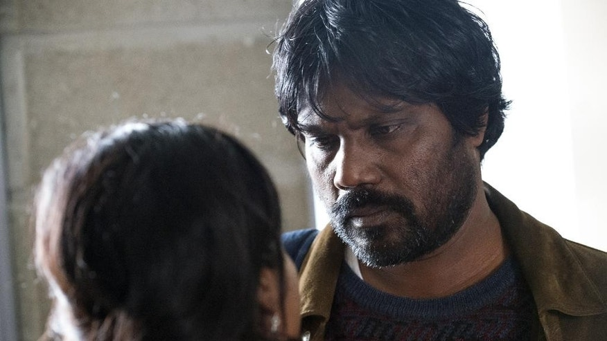 "This image released by Sundance Selects shows Kalieaswari Srinivasan, left, and Jesuthasan Antonythasan in a scene from ""Dheepan."" (Paul Arnaud/Sundance Selects via AP)"