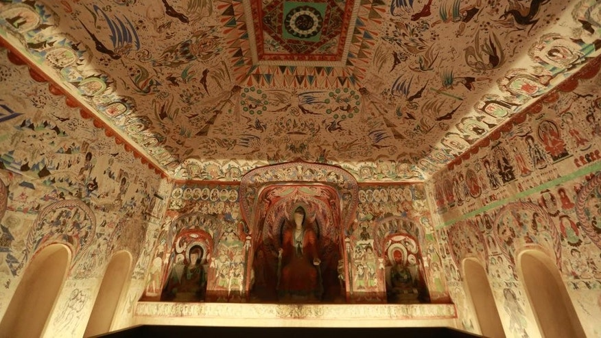 "This Wednesday, May 4, 2016, photo shows a full-scale, hand-painted replica of one of China's Cave Temples of Dunhuang, Cave 285, on display at the J. Paul Getty Museum in Los Angeles. The exhibit ""Cave Temples of Dunhuang: Buddhist Art on the Silk Road"" opens Saturday, May 7, and runs until Sept. 4, 2016 at the Getty Center. (AP Photo/Damian Dovarganes)"