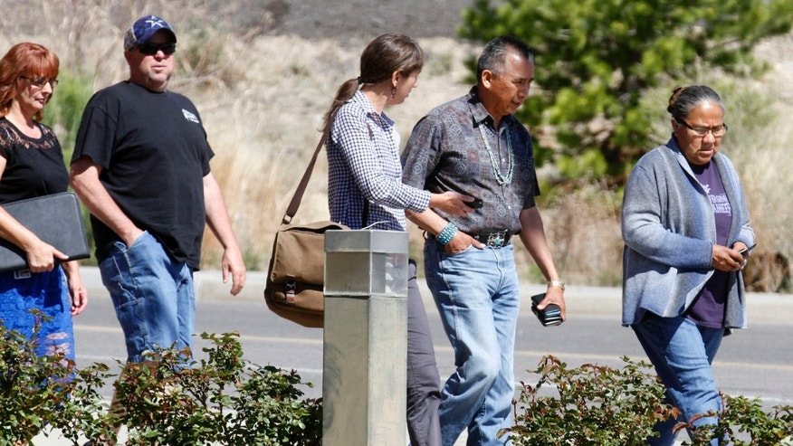 San Juan Chapter President Rick Nez, second from right, walks out of the Farmington Municipal Court building on Wednesday, May 4, 2016 after an initial court hearing for Tom Begaye, who has been accused of abducting and killing 11-year-old Ashlynne Mike.