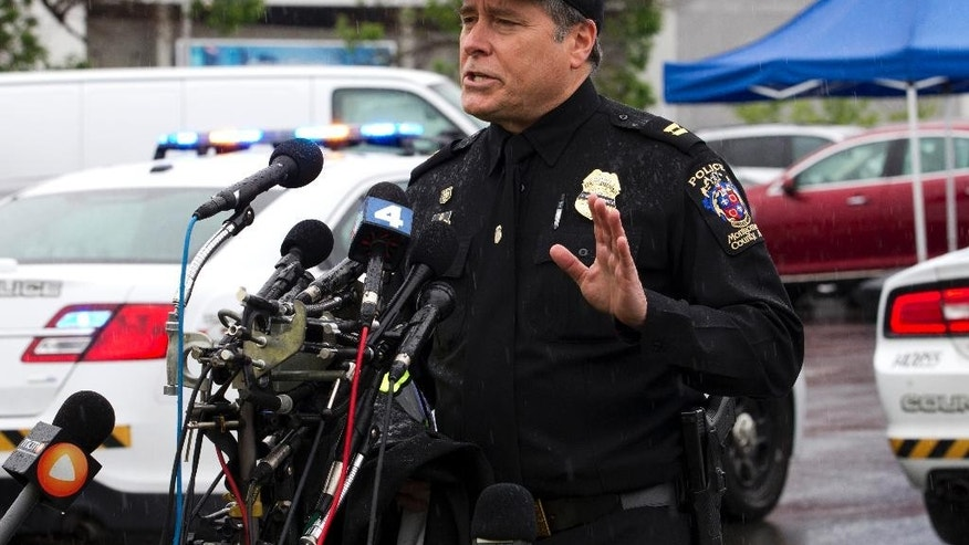 Montgomery County, Md. Police Capt. Paul Starks speaks to the media in the parking lot outside the Westfield Montgomery Mall in Bethesda, Md., Friday, May 6, 2016. A woman was killed and three people were wounded in two shootings within an hour Friday at a mall and a shopping center in the Washington suburbs, police said. (AP Photo/Jose Luis Magana)