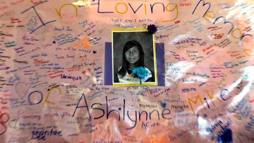 Messages from the community are written on a poster for Ashlynne Mike on display inside the lobby of the Farmington Civic Center on Friday, May 6, 2016, in Farmington, N.M. She was a budding musician and talented artist, a girl whose death at the hands of a man who authorities say lured her into his van spread grief far beyond her home on the Navajo Nation. More than 3,000 people turned out for her funeral. (Jon Austria/The Daily Times via AP) MANDATORY CREDIT