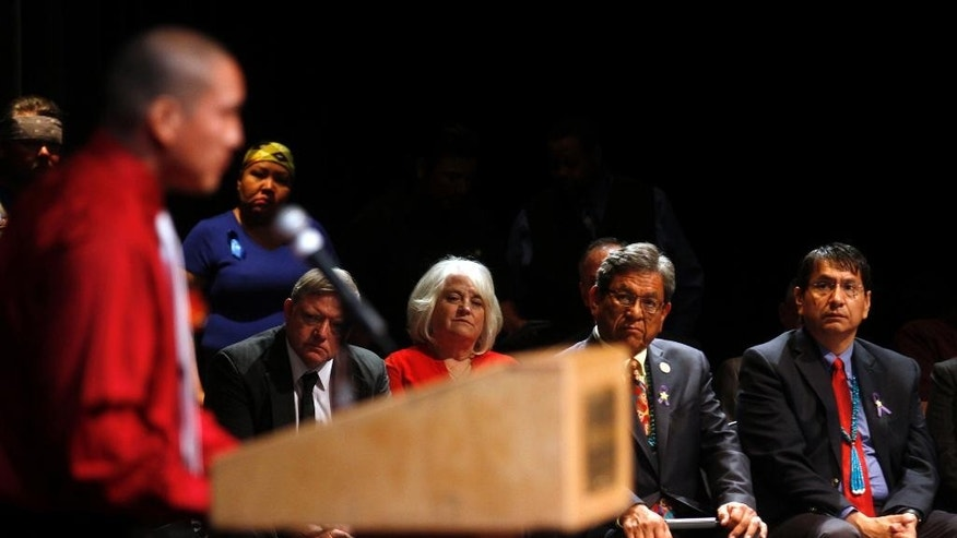 Ryan Begay, left, gives a eulogy for his sister Ashlynne Mike, as dignitaries, from left, Gary McDaniel, his wife, County Commissioner District 2 Margaret McDaniel, Navajo Nation President Russell Begaye and Navajo Nation Vice President Jonathan Nez listen, during the funeral service for Ashlynne Mike at the Farmington Civic Center on Friday, May 6, 2016, in Farmington, N.M. She was a budding musician and talented artist, a girl whose death at the hands of a man who authorities say lured her into his van spread grief far beyond her home on the Navajo Nation. More than 3,000 people turned out for her funeral. (Jon Austria/The Daily Times via AP) MANDATORY CREDIT