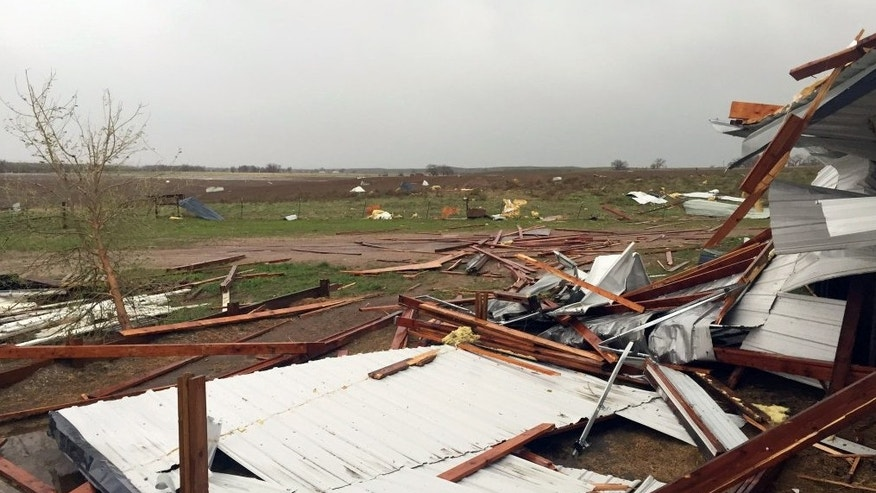 Debris lies scattered on the ground after a tornado was reported in Weld County outside Wiggins, Colo., Saturday, May 7, 2016. Spring storms menaced parts of the West on Saturday, bringing hail and a tornado sighting in Colorado and deadly driving conditions in Arizona. (Kristen Skovira/KMGH-Channel 7 via AP) MANDATORY CREDIT