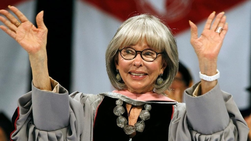 Rita Moreno waves after receiving an honorary doctor of music degree from Berklee College of Music during commencement ceremonies in Boston, Saturday, May 7, 2016. (AP Photo/Michael Dwyer)
