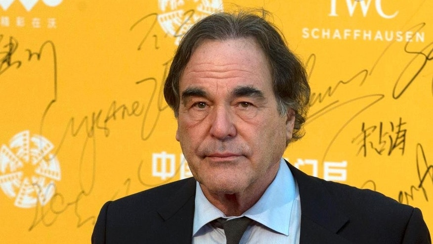 FILE - This April 16, 2014 file photo shows director Oliver Stone at the 4th Beijing International Film Festival held in Beijing, China. On Saturday, May 7, 2016, Stone told University of Connecticut graduates of his academic failures that led him to drop out of school for a while before starting fresh at a new university and ultimately launching a successful film career, during a graduate school commencement address at UConn's main campus in Storrs, Conn. (AP Photo/Ng Han Guan, File)