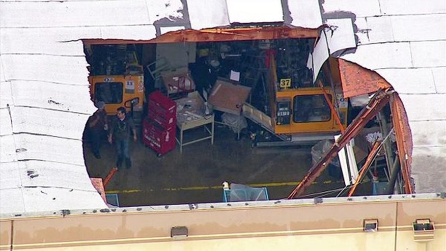 This still frame from aerial video provided by KABC-TV shows the roof of a large industrial building in Ontario, Calif., that collapsed under the weight of accumulated rain water as a rain storm moved through Southern California Friday, May 6, 2016. Rain caused flash flooding on Interstate 5 near the Grapevine. (KABC-TV via AP) MANDATORY CREDIT; TV OUT