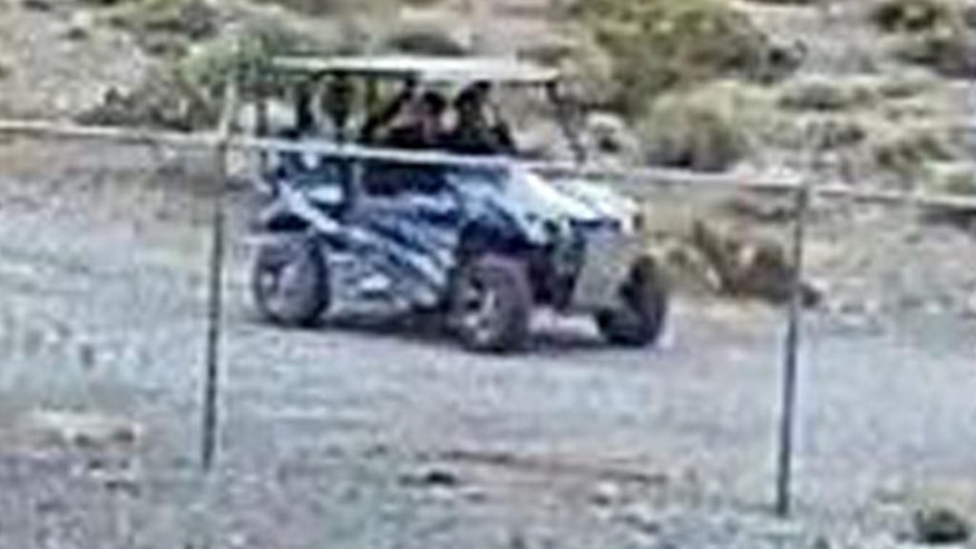 In this still image taken from security video on Saturday, April 30, 2016 and released by the National Park Service, three men on an off-road vehicle are seen in Death Valley National Park, Nev. Authorities on Monday were searching for three men who went on a drunken binge in an environmentally fragile area of Death Valley National Park, leaving behind beer cans, shotgun shells, vomit, underwear — and possibly killing one of the rarest fishes on earth, a Devils Hole pupfish. (National Park Service via AP)