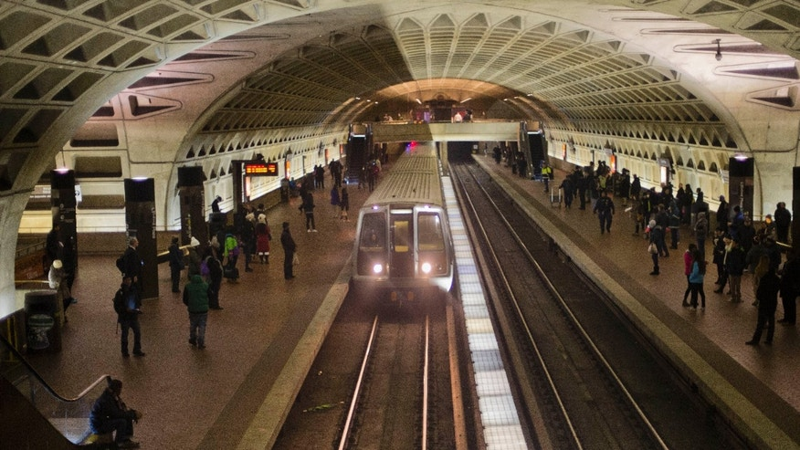 In this Jan. 13, 2015 file photo, a subway train arrives at the L'Enfant Metro Station in Washington.