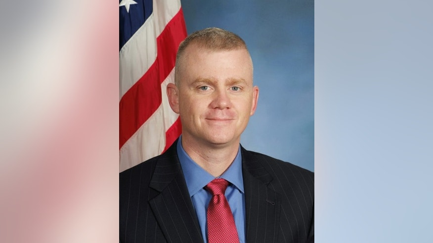 This undated image provided by the Kansas City Police Department shows Brad Lancaster. The police detective was fatally shot Monday, May 9, 2016, while investigating reports of a suspicious person near a racetrack in Kansas City, Kan. He died after undergoing surgery, his department said in a statement. (Kansas City Police Department via AP)