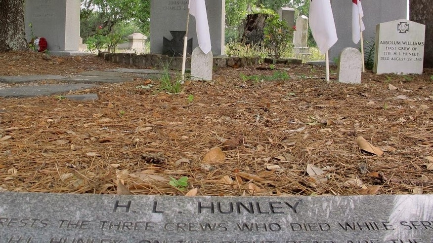 "Confederate flags are seen at the plot where crew members of the Confederate submarine H.L. Hunley are buried at Magnolia Cemetery in Charleston., S.C., on Tuesday, May 10, 2016. The Hunley was the first submarine in history to sink an enemy warship. May 10 is observed as Confederate Memorial Day in the Carolinas. It is the date when Confederate Gen. Thomas ""Stonewall"" Jackson died in 1863. (AP Photo/Bruce Smith)"