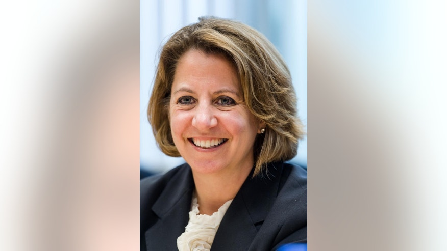 Lisa Monaco, assistant to the U.S. president for homeland security and counterterrorism smiles as she talks with journalists at the U.S. - European Media Hub in Brussels on Tuesday May 10, 2016. A U.S. government delegation is in Belgium to promote greater intelligence-sharing by Belgian and European authorities in the wake of the March bombings that killed 32 victims in Brussels. (AP Photo/Geert Vanden Wijngaert)