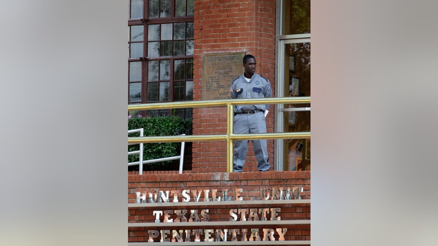 FILE - In this Sept. 21, 2011 file photo, a corrections officer keeps watch outside the Texas Department of Criminal Justice Huntsville Unit in Huntsville, Texas. A two-year dispute about execution drugs in the nation's most active death penalty state is returning to court as Texas seeks to keep secret the identity of whoever provided its drugs for lethal injections before a law last year clamped a firm lid on any supplier's name. (AP Photo/David J. Phillip, File)
