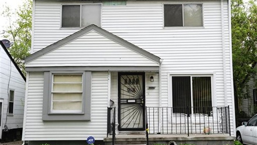 This photo taken Wednesday morning, May 11, 2016, shows the exterior of home in Detroit where Police say a young girl fatally shot herself after finding a handgun under her grandmother's pillow. (Todd McInturf/Detroit News via AP)