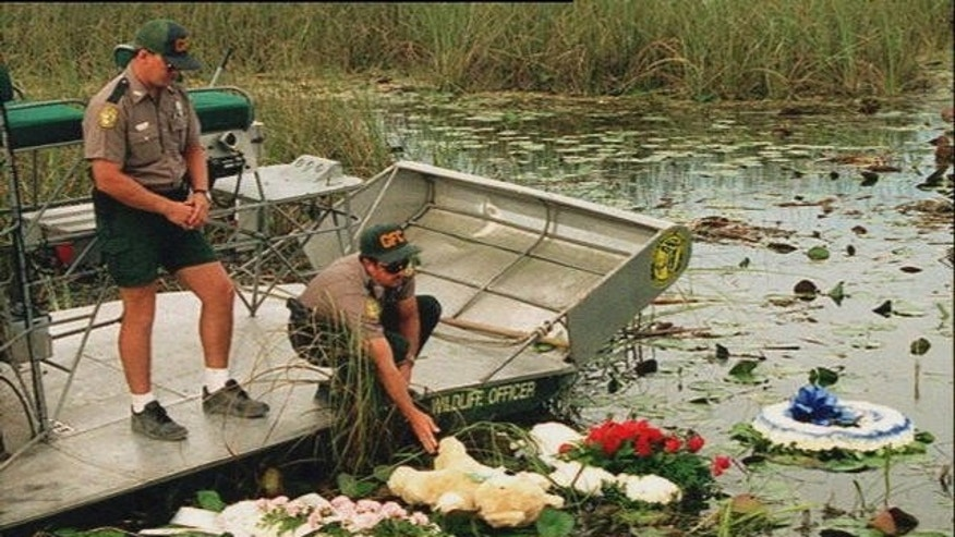 May 1996: Officers lay wreaths on the water at the site of the ValuJet Flight 592 crash.