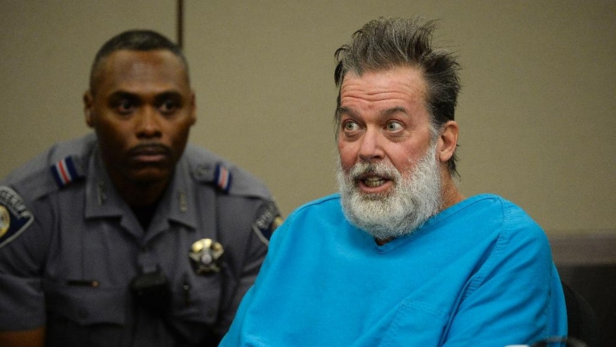 FILE - In this Dec. 9, 2015 file photo, Robert Lewis Dear talks to Judge Gilbert Martinez during a court appearance in Colorado Springs, Colo. The judge is set to rule on the mental state of Dear who acknowledged killing three people at a Planned Parenthood clinic in Colorado. Martinez is expected to announce Wednesday, May 11, 2016, whether criminal proceedings should continue against 57-year-old Dear. (Andy Cross/The Denver Post via AP, Pool, File)