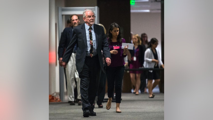 State psychologist B. Thomas Gray leaves the courtroom during a recess from a competency hearing for Robert Dear, Jr., Tuesday, May 10, 2016, in the El Paso Country Judicial Building in Colorado Springs, Colo. Dear is charged with 179 counts, including murder, attempted murder and assault, in the Nov. 27, 2015, shootings at a Colorado Springs Planned Parenthood clinic. (Christian Murdock/The Gazette via AP, Pool)