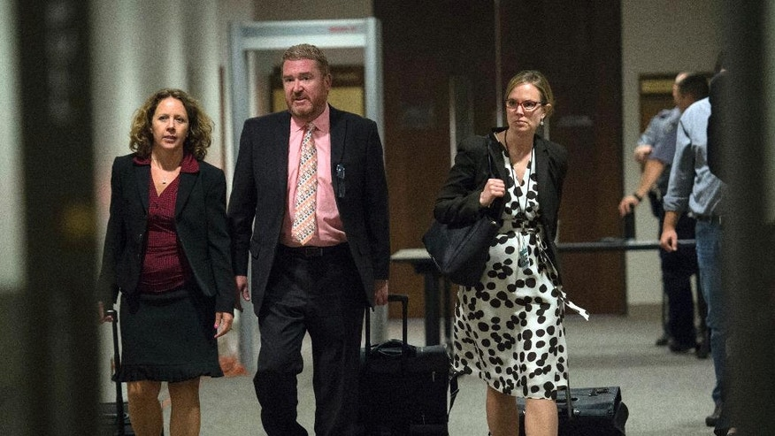Public defenders Rosalie Roy, left, Dan King and Kristen Nelson leave the competency hearing for Robert Dear, Jr., Tuesday, May 10, 2016, in the El Paso Country Judicial Building in Colorado Springs, Colo. Dear is charged with 179 counts, including murder, attempted murder and assault, in the Nov. 27, 2015, shootings at a Colorado Springs Planned Parenthood clinic. (Christian Murdock/The Gazette via AP, Pool)