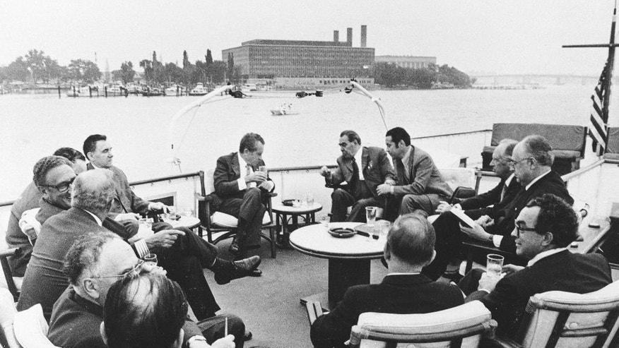 FILE- In this June 19, 1973, file photo, president Richard Nixon, center left, is engaged in a conversation with Soviet leader Leonid Brezhnev, center right, while sailing down the Potomac River aboard the yacht Sequoia. A Delaware judge is holding a hearing Wednesday, May 11, 2016, to determine a price at which a lender can exercise an option to purchase the former presidential yacht Sequoia or cede possession to its current owners. (AP Photo, File)