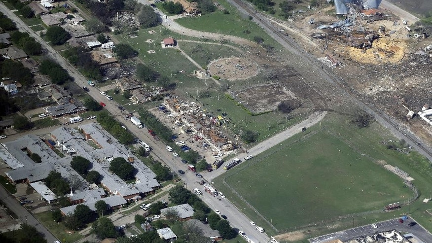 FILE - This April 18, 2013 aerial file photo shows the remains of a nursing home, left, apartment complex, center, and fertilizer plant, right, destroyed by an explosion at a fertilizer plant in West, Texas. Federal authorities announced Wednesday, May 11, 2016, that the fire that caused the deadly explosion in 2013 was a criminal act. The explosion killed 15 people, injured hundreds and left part of the small town in ruins. (AP Photo/Tony Gutierrez, File)