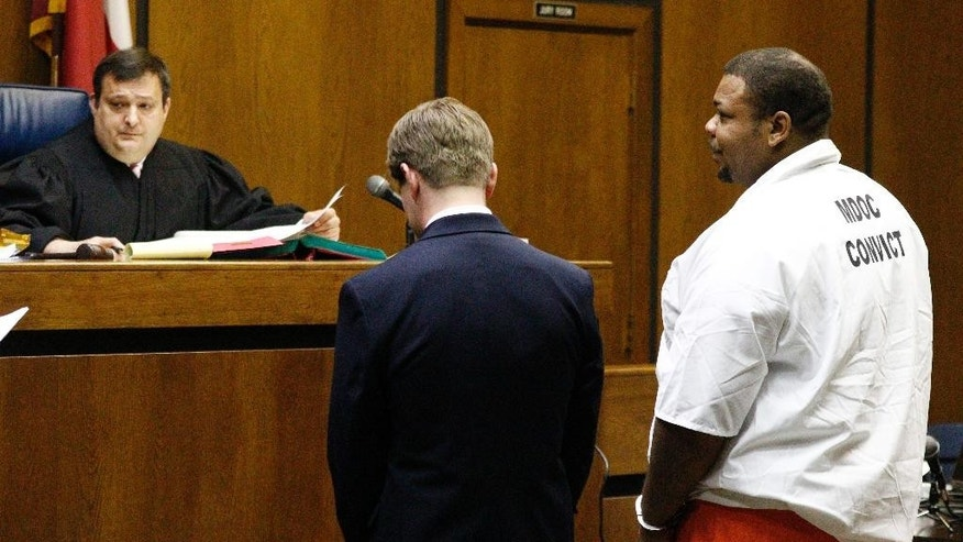 Attorney Neal Marlow, center, stands with his client Odell Hallmon, right, as they and Circuit Judge Joey Loper, listen as the criminal charges are read to him in the Montgomery County Courthouse in Winona, Miss., Wednesday, May 11, 2016, Hallmon pleaded guilty to three counts of first-degree murder as well as pleading guilty to one count of aggravated assault and one count of being a felon in possession of a firearm. He was sentenced to life in prison without parole. The ex-convict says he's responsible for the shooting deaths of his son's mother and grandmother and another man in rural Mississippi in April 27, 2016. (AP Photo/Rogelio V. Solis)