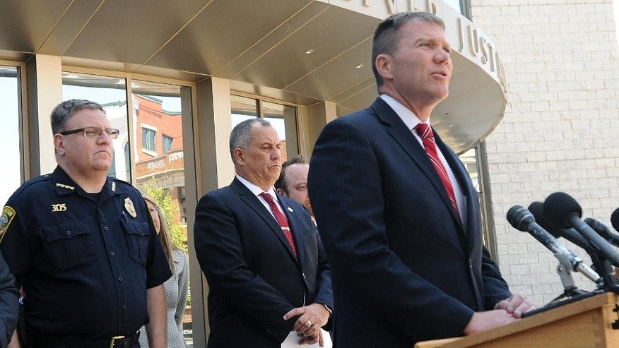 Taunton, Mass., Mayor Thomas Hoye, Jr., right, speaks about Tuesday's stabbings at a Taunton home and shopping mall, Wednesday, May 11, 2016, in Fall River, Mass. Behind him are Taunton Police Chief Edward Walsh, left, and Bristol County District Attorney Thomas Quinn III. Arthur DaRosa, described by his family as mentally disturbed, went on a stabbing rampage hours after leaving a hospital. He killed two people and assaulted and stabbed others before being fatally shot by an off-duty sheriff's deputy at the Silver City Galleria mall. (Jack Foley/The Herald News of Fall River via AP) MANDATORY CREDIT
