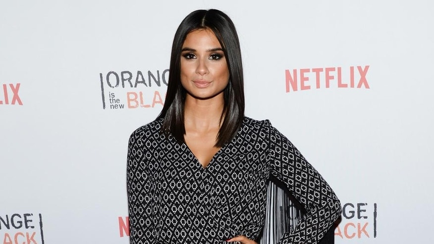 "FILE- IN this June 11, 2015, file photo, actress Diane Guerrero attends Netflix's ""Orange is the New Black"" ORANGECON Celebration at Skylight Clarkson SQ in New York. The depression, the anxiety and the emotional instability that Guerrero went through due to the separation from her parents are some of the points she writes about in her new memoir ""In the Country We Love: My Family Divided,"" as well as her later professional development and her work in the successful Netflix series ""Orange Is The New Black"" and The CW's ""Jane The Virgin."" (Photo by Evan Agostini/Invision/AP)"