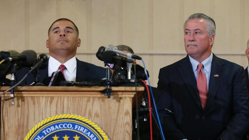 McLennan County district attorney Able Reyna, left. and Bureau of Alcohol, Tobacco and Firearms special agent Robert Elder, right, talk to reporters  reporters during a press conference, Wednesday, May 11, 2016, in West, Texas. Elder said the fire that led to an explosion at the West, Texas, fertilizer plant that killed 15 people in 2013 was a criminal act. Elder said investigators came to the conclusion after ruling out other reasonable causes, but he didn't release specifics. (Rod Aydelotte/Waco Tribune-Herald, via AP)